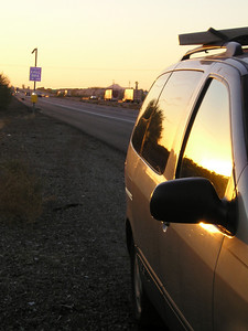 How lucky are we? It's still daylight but not hot, so we get a sunset and it's not stifling in or near the car, AND there's a callbox about 3 steps behind us! Normally I'd change the tire myself, but although we're off the pavement, we're still too close to 70-MPH bigrigs for my comfort. I crave a ginormous tow truck protecting us.
