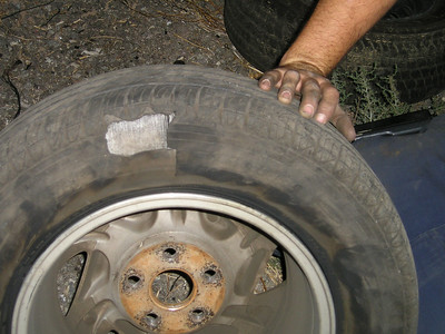 This is why we couldn't find the problem--it was on the inside of the tire where we couldn't see it and, even though we ran our hands around the back sides, didn't quite feel it.