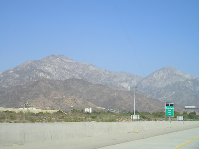 Turning east on I-210 in Los Angeles, the south sides of the mountains rise sharply and almost clearly from the valley floor. To research later: The origin of these mountains.