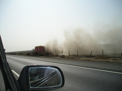 The Central Valley's air was extremely visible this trip. After watching the dust rise from this truck in a field (and several tractors and so on), we could see why the haze was so dense.