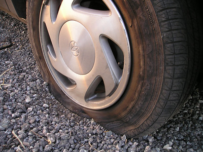 The tires all look perfect. Back on the freeway, drive two miles, and POW BAM wobble wobble wobble. OK, now we have definitely lost a tire. We pull gradually over to the side of the road.