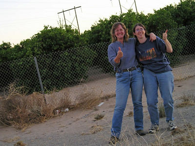 Thelma and Louise waiting for the AAA Guy. WHile we're there, a nice CHP guy comes by and asks if we're going to the dog show in Scottsdale. What the--?  Apparently he's already pulled over a couple of dogshow people along this stretch of highway. We actually drive the speed limit. See how we're rewarded?
