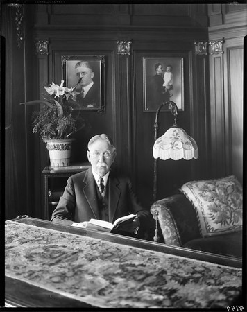 Edward Doheny with book, office, Doheny Mansion, Los Angeles, Calif., ca. 1931-1932