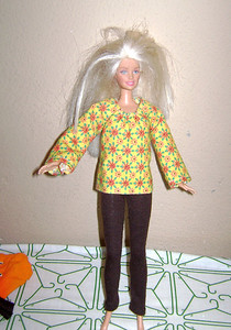 Brown Leggings and Yellow, Orange, & Green Flower Print Long Sleeve Top with thread gathered neckline. This has Velcro closure in back.