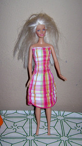 Pink, Orange, & Green Plaid Strapless Sundress with Shirred Bodice, two tucks in skirt, and hem of large scallops.