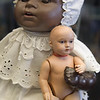 Black doll with white baby doll