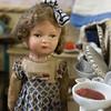 Doll in puppet kitchen