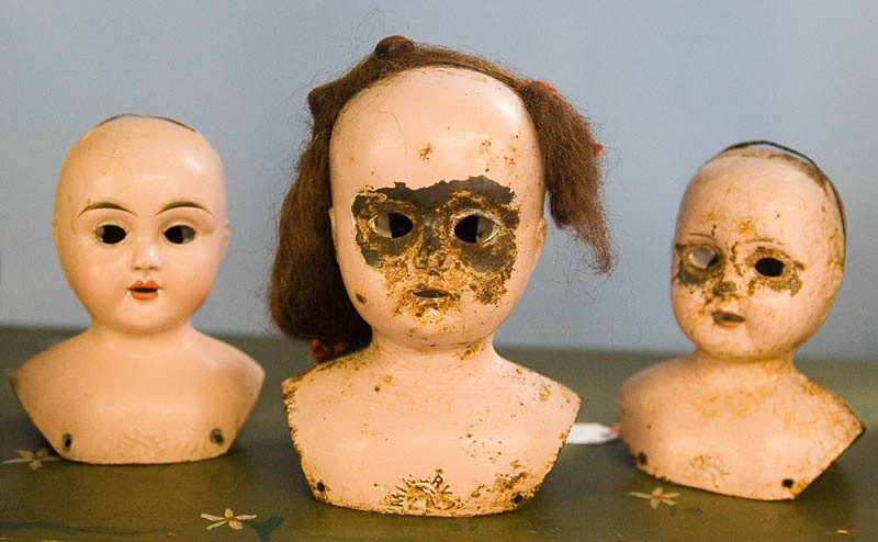 Old tin doll heads