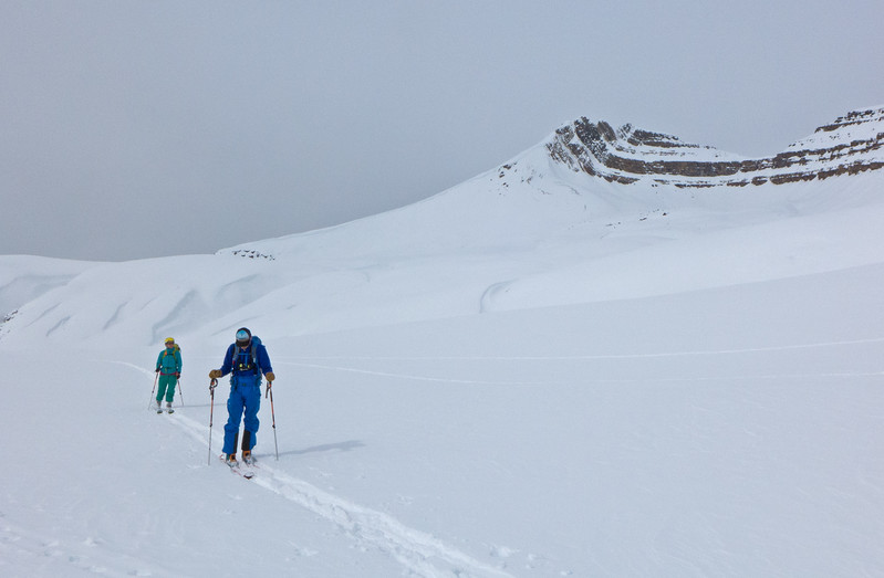 After a good run down in soft snow but flat light, the sun came out at Dolomite Pass, below Cirque Peak.