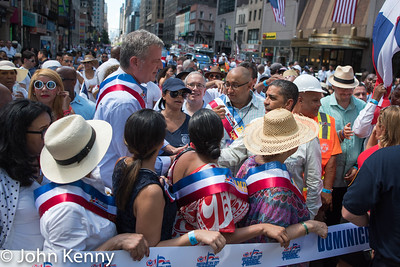 Mayor Bill de Blasio greets State Senator Adriano Espaillat as he arrived at the ceremonial ribbon cutting.  A mayoral aide stood between de Blasio and Comptroller Scott Stringer, who de Blasio ignored.  Dominican Day Parade 8/14/16