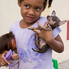 Young girl with chihuahua and doll, Rio San Juan, Dominican Republic.