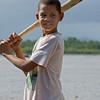 Boy with handmade baseball bat, Rio San Juan, Dominican Republic.