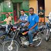 Motoconcho (taxi) drivers waiting for their next fare, Rio San Juan, Dominican Republic.