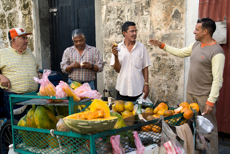 Men having morning snack at vendor's cart, Santo Domingo, Dominican Republic.