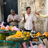Men having morning snack at vendor's cart, Santo Domingo, Dominican Republic.