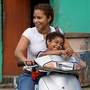 Mother and daughter on motorbike, Rio San Juan, Dominican Republic.