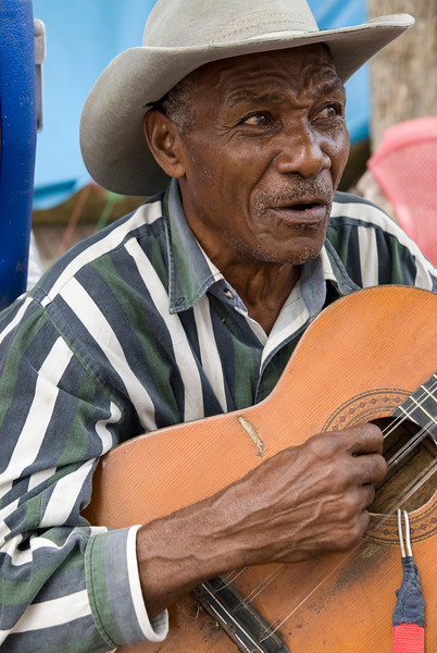Man singing and playing guitar, Samaná, Dominican Republic.