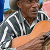Man singing and playing guitar, Samaná, Dominican Republic.