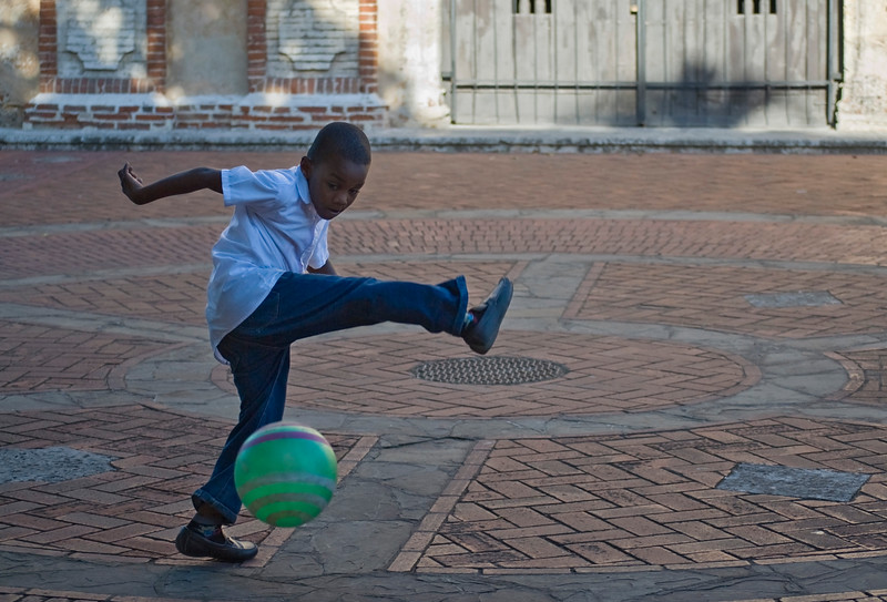 Boy playing in plaza, Santo Domingo, Dominican Republic