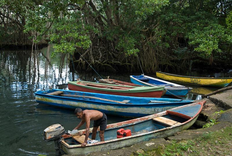 Man prepares for fishing trip in Laguna Gri-Gri, Rio San Juan, Dominican Republic.