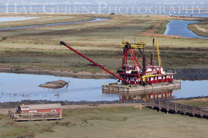 The dredger Mallard II has been continuously restoring the levees since 1936.<br /> Don Edwards Natl Wildlife Refuge, Fremont, California<br /> 0706R-MIID10