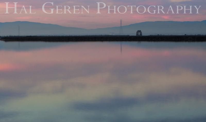 Reflections<br /> Moffet Field blimp hanger, power tower, and Dumbarton Railroad swing bridge from over a salt pond<br /> Don Edwards National Wildlife Refuge.  Fremont, CA<br /> 1009R-SR2