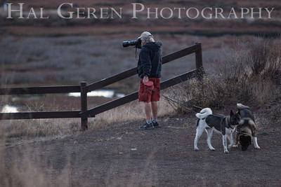 A real photographer only needs one hand.  Dennis, Charlotte, and Kirin on the trail Don Edwards National Wildlife Reserve Fremont, California 1310R-DCAKR1
