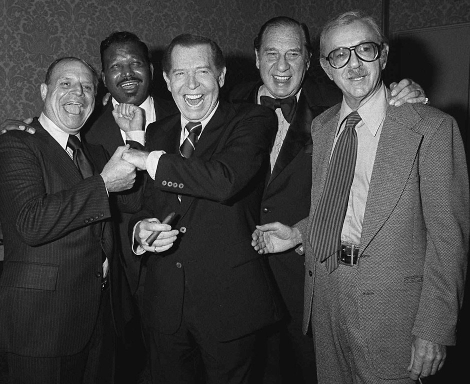 . Comedian Henny Youngman, second from right, clowns with celebrities, left to right, Don Rickles, Sugar Ray, Milton Berle and Jack Albertson in the Beverly Hills, California Hilton on Nov. 17, 1978. Youngman, the Borscht Belt comic dubbed the king of one-liners for cracks like the immortal ``Take my wife --please,\'\' died Tuesday, Feb. 24, 1998. He was 91. (AP Photo/Doug Pizac)