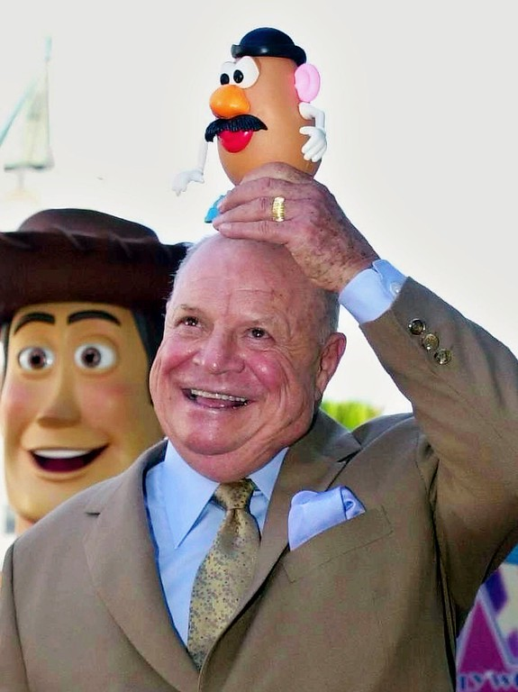 ". Actor/comedian Don Rickles smiles for photographers while placing Mr. Potato Head on top of his head after receiving his star on the Hollywood Walk of Fame in Los Angeles Tuesday, Oct. 17, 2000. Rickles provides the voice of Mr. Potato Head for the film, ""Toy Story.\""  In background, at left, is the film\'s character \""Woody.\""  (AP Photo/Michael Caulfield)"