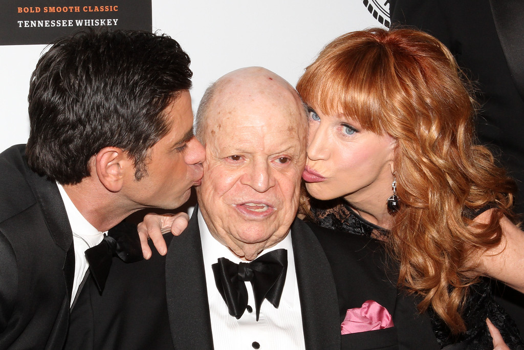 . Actor John Stamos, Honoree Don Rickles and Comedian Kathy Griffin pose for photos at the Friars Club Roast in his honor at the Waldorf Astoria on Monday, June 24, 2013 in New York. (Photo by Greg Allen/Invision/AP)