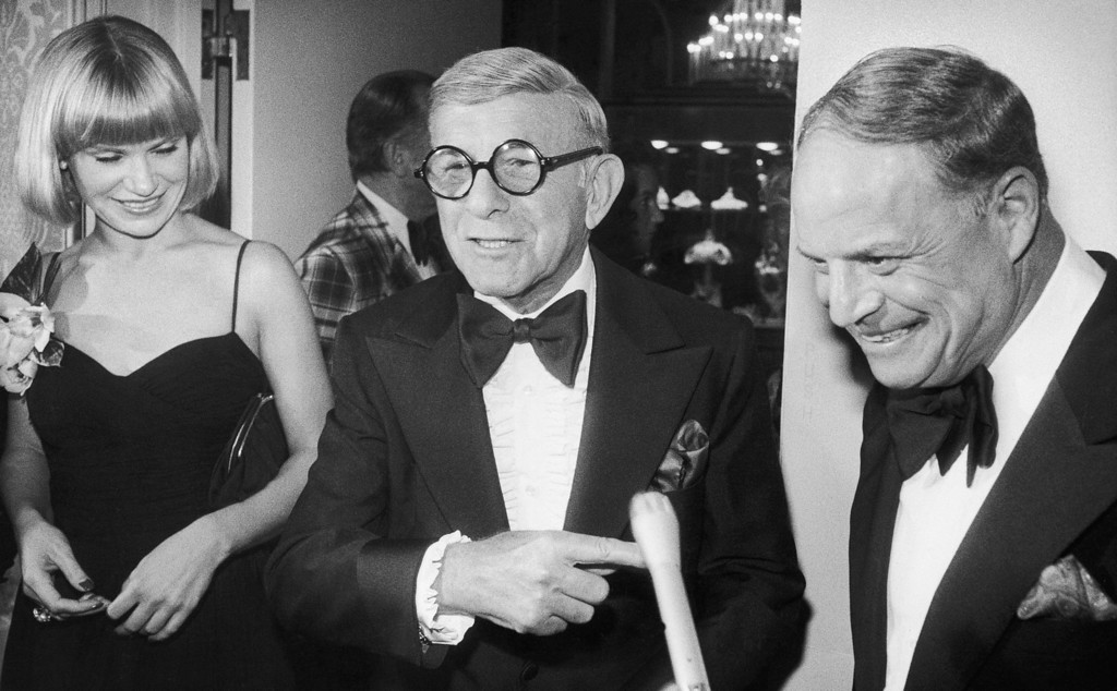 . Comedian Don Rickles, right, jokes with George Burns and friend Lisa Miller at a cocktail party, prior to the Friars Club annual dinner on Friday, Oct. 15, 1976 at the Beverly Hilton, Beverly Hills. Burns is the guest of honor and Rickles is master of ceremonies at the dinner, joined by many celebrities including Helen Reddy, Milton Berle, Phil Silvers, Connie Stevens, George Jessel and Tony Martin. (AP Photo)