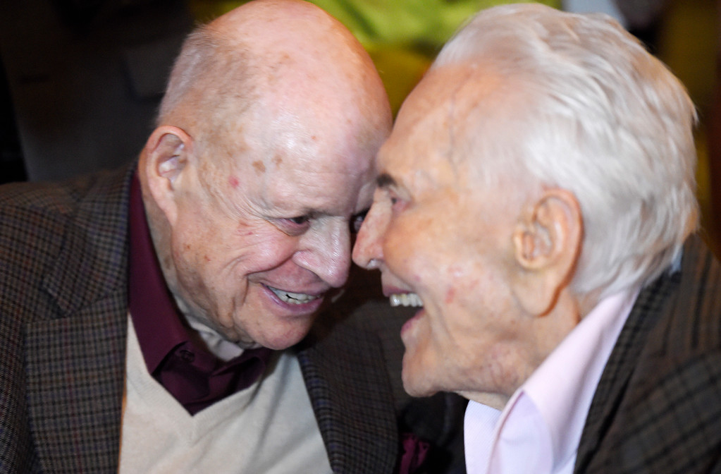 . Comedian Don Rickles, left, laughs with actor Kirk Douglas at Douglas\' 100th birthday party at the Beverly Hills Hotel on Friday, Dec. 9. 2016, in Beverly Hills, Calif. (Photo by Chris Pizzello/Invision/AP)