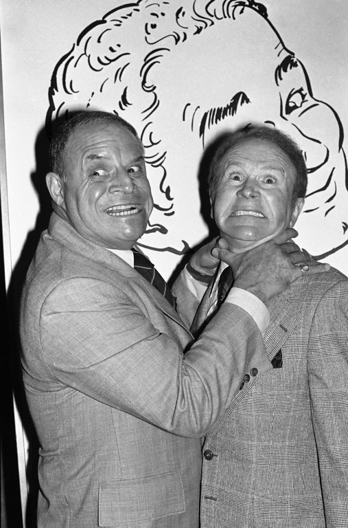 . Comedian Don Rickles hugs Red Buttons as they clown for photographers prior to an Annual Stag Roast in Los Angeles on Thursday, Nov. 10, 1977.   Buttons was the subject of the roast, proceed from which will establish the Red Buttons Fellowship Fund in Preventive Medicine at the City of Hope in Los Angeles. (AP Photo/ Lennox McLendon)