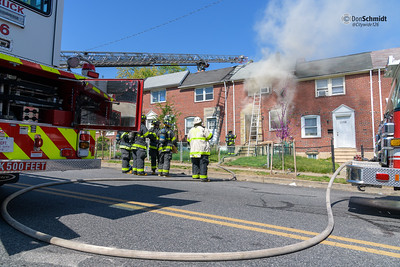 Baltimore City Box 35-10, 3612 10th St. Fire in an occupied rowhouse. Dog removed and resuscitation attempted. Anne Arundel County Truck 31 on line box.
