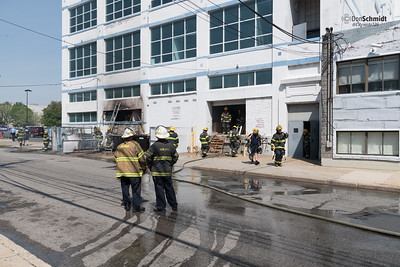 Philadelphia Box 391, N. 8th Street and Callowhill Street. Multiple dumpsters extended to an occupied 5 story commercial building.