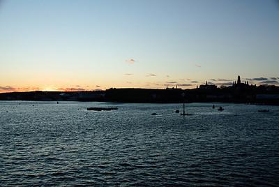 Setting Sun over Gloucester Harbor