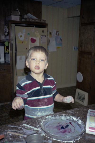 Scott playing in kitchen