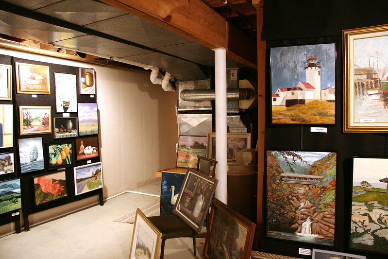 Paul Kremer paintings in basement after show - July 2, 2005