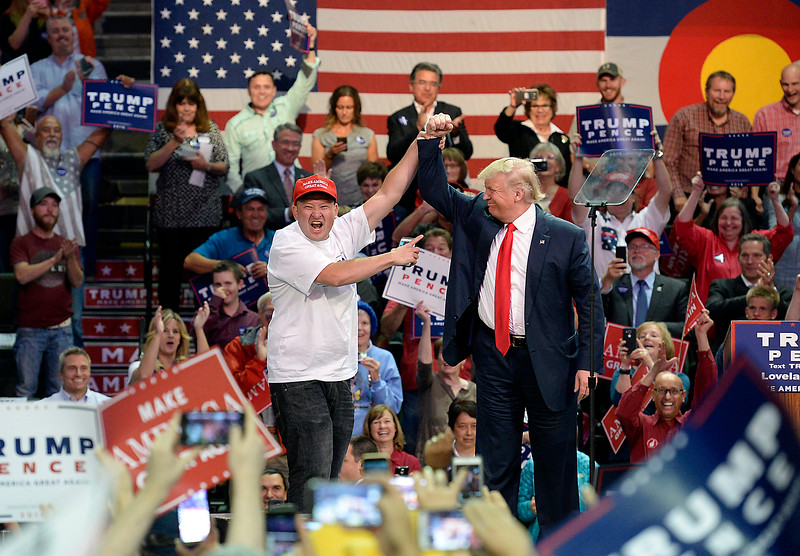 Donald Trump After being pulled up on stage because he was the first person in line for a Trump rally, a man shares a moment with the presidential candidate Monday, Oct. 3, 2016, during a rally at the Budweiser Events Center in Loveland. (Photo by Jenny Sparks/Loveland Reporter-Herald)
