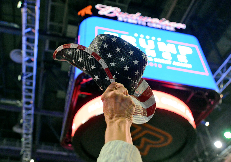 Sandra Lull of Loveland raises her cowboy hat Monday, Oct. 3, 2016, during a Donald Trump rally at the Budweiser Events Center in Loveland. (Photo by Jenny Sparks/Loveland Reporter-Herald)