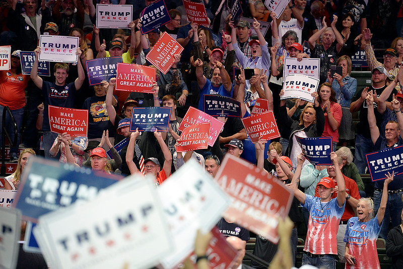 Supporters wave signs Monday, Oct. 3, 2016, during a Donald Trump rally at the Budweiser Events Center in Loveland. (Photo by Jenny Sparks/Loveland Reporter-Herald)
