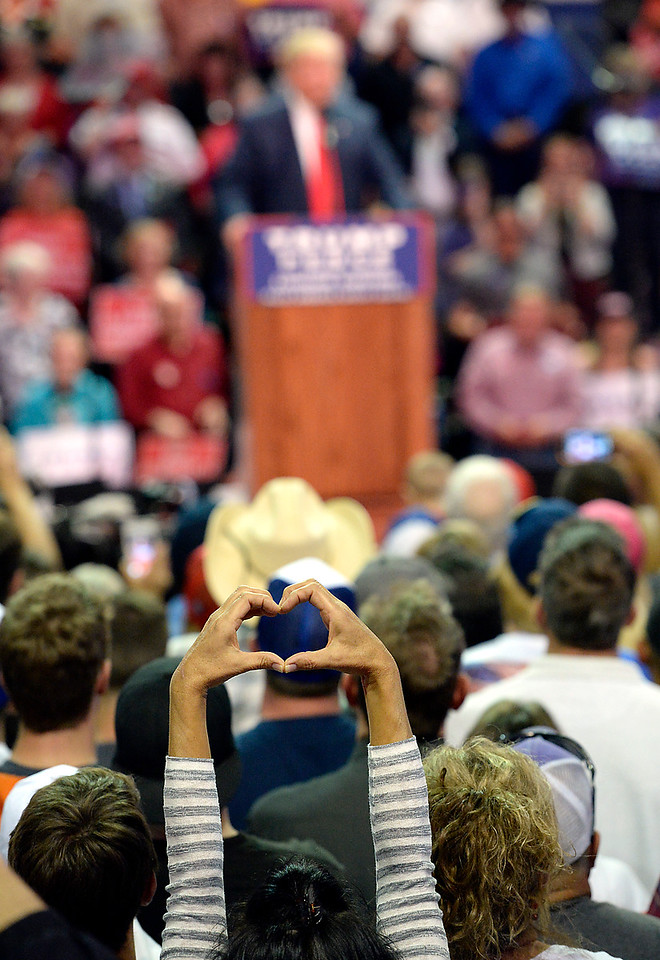 A Donald Trump supporter makes a heart sign as he speaks Monday, Oct. 3, 2016, during a rally at the Budweiser Events Center in Loveland. (Photo by Jenny Sparks/Loveland Reporter-Herald)