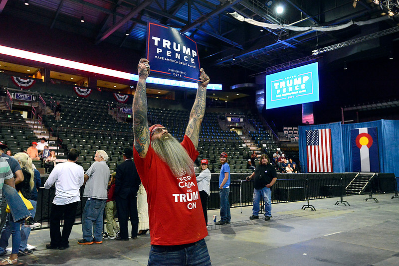 Twister Asturi of Loveland holds up a Trump sign Monday, Oct. 3, 2016, while standing in the Budweiser Events Center during a Donald Trump rally in Loveland. (Photo by Jenny Sparks/Loveland Reporter-Herald)