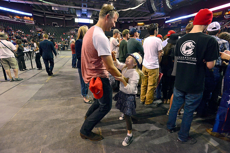 Lydia Dirkmaat, 9, dances with her dad, Dallon Dirkmaat Monday, Oct. 3, 2016, during a Donald Trump rally at the Budweiser Events Center in Loveland. (Photo by Jenny Sparks/Loveland Reporter-Herald)