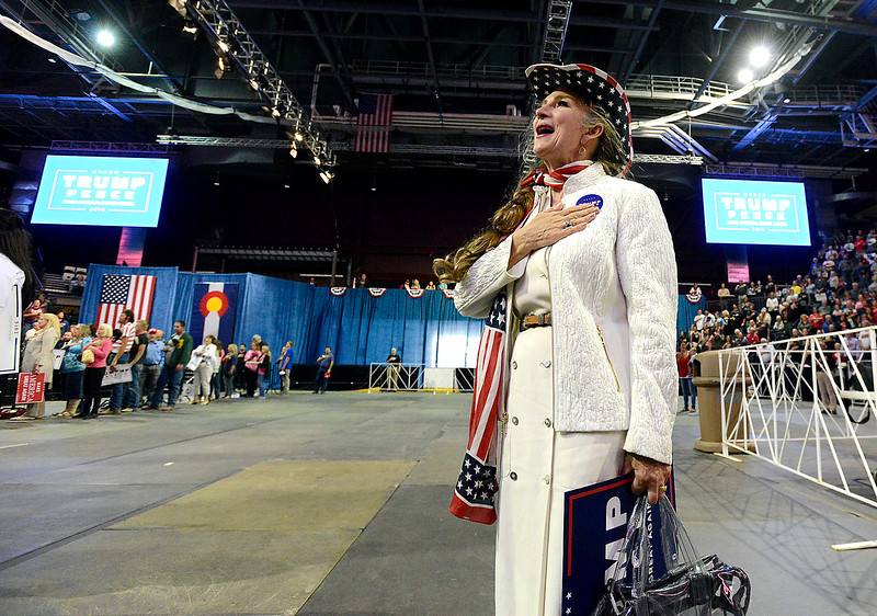 Sandra Lull of Loveland sings the National Anthem Monday, Oct. 3, 2016, during a Donald Trump rally at the Budweiser Events Center in Loveland. (Photo by Jenny Sparks/Loveland Reporter-Herald)