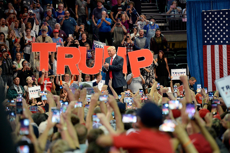 Donald Trump enters the Budweiser Events Center Monday, Oct. 3, 2016, to a full crowd cheering during a rally in Loveland. (Photo by Jenny Sparks/Loveland Reporter-Herald)