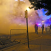 Protesters disperse after the Albuquerque Police Department shot tear gas during a Donald Trump Rally at the Albuquerque Convention Center on Tuesday, May 24, 2016. Luis Sanchez Saturno/The New Mexican