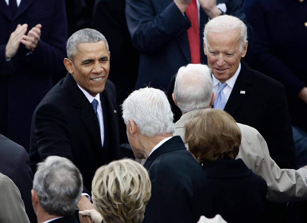 . President Barack Obama greets Former President Bill Clinton before the 58th Presidential Inauguration at the U.S. Capitol in Washington, Friday, Jan. 20, 2017. Right is Vice President Joe Biden. (AP Photo/Matt Rourke)