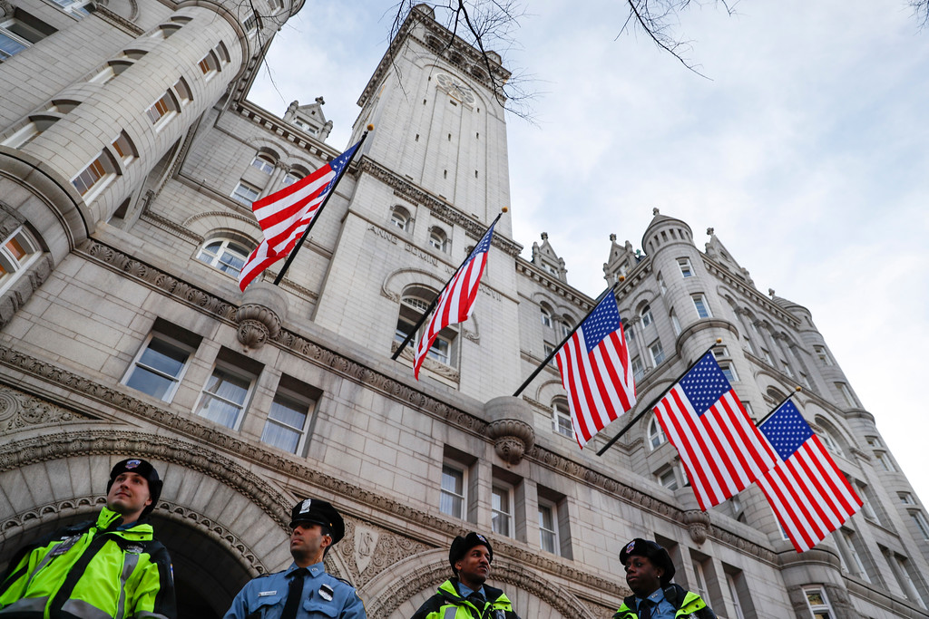 . Police stand guard outside the Trump International Hotel on Pennsylvania Avenue in Washington, Thursday, Jan. 19, 2017, as security tightens ahead of Friday\'s presidential inauguration. (AP Photo/John Minchillo)