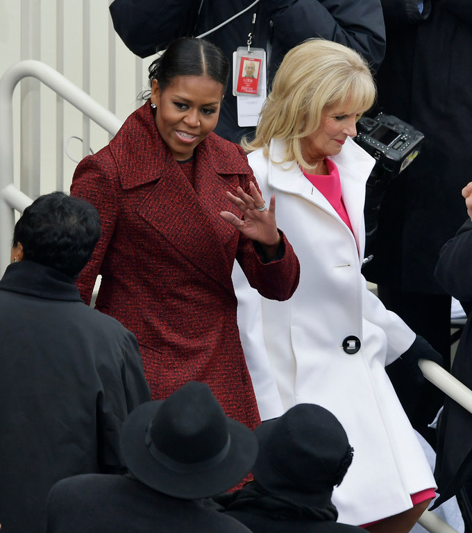 . First Lady Michelle Obama, left, arrives with Vice President Joe Biden\'s wife, Dr. Jill Biden for the 58th Presidential Inauguration for President-elect Donald Trump at the U.S. Capitol in Washington, Friday, Jan. 20, 2017.(AP Photo/Susan Walsh)
